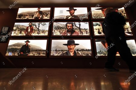 Stock Image of Clint Eastwood, Eli Wallach and Lee Van Cleef appear on screens in the three-way standoff in 'The Good, the Bad and the Ugly' on display in the exhibition 'C'era una volta Sergio Leone', in Ara Pacis museum in Rome, Italy, 16 December 2019. The exhibition running from 17 December to 03 May 2020 pays tribute to Italian film director, producer and screenwriter Sergio Leone (1929-1989).