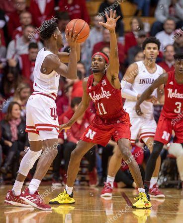 Dachon Burke Jr., Al Durham. Nebraska guard Dachon Burke Jr. (11) guards Indiana guard Al Durham (1) during the second half of an NCAA college basketball game, in Bloomington, Ind. Indiana won 96-90 in OT