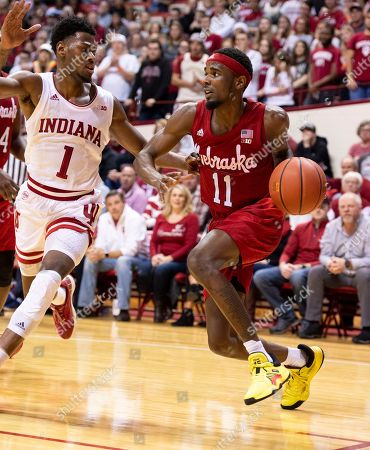 Dachon Burke Jr., Al Durham. Nebraska guard Dachon Burke Jr. (11) drives the ball along the baseline as he's defended by Indiana guard Al Durham (1) during the second half of an NCAA college basketball game, in Bloomington, Ind. Indiana won 96-90 in OT