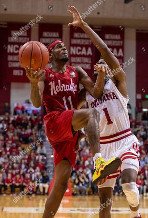 Dachon Burke Jr., Al Durham. Nebraska guard Dachon Burke Jr. (11) drives to the basket as he's defended by Indiana guard Al Durham (1) during the second half of an NCAA college basketball game, in Bloomington, Ind. Indiana won 96-90 in OT