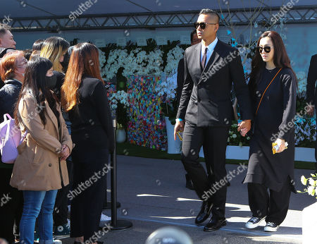 Stock Photo of Blackie Chen and Christine Fan depart the funeral parlour