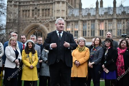 SNP Westminster leader Ian Blackford with 48 Newly elected SNP MPs at a photocall near the Houses of Parliament in Westminster, London.