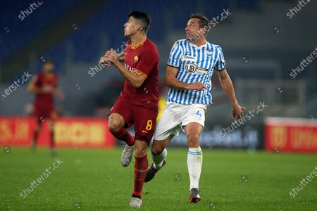 Diego Perotti of Roma in action against Thiago Cionek of Spal