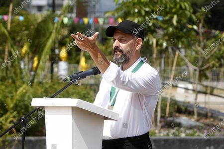 Swiss artist Ugo Rondinone speaks during the inauguration of his sculpture 'Montana Medellin' (lit. Medellin Mountain) at Parques del Rio in Medellin, Colombia, 16 December 2019.