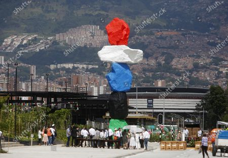 View of the sculpture 'Montana Medellin' (lit. Medellin Mountain) by Swiss artist Ugo Rondinone during its inauguration at Parques del Rio in Medellin, Colombia, 16 December 2019.