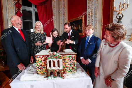 Norway's King Harald (L-R), Crown Princess Mette-Marit, Princess Ingrid Alexandra, Crown Prince Haakon, Prince Sverre Magnus and Queen Sonja admire the gingerbread house made by children from Fridheim kindergarden during Christmas photography in the Royal Palace in Oslo, Norway, 16 December 2019. The royal couple will celebrate Christmas at Kongseter together with Princess Martha. The Crown Prince couple spends Christmas in Uvdal.