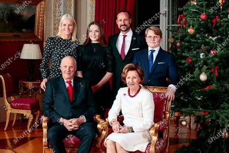 Stock Image of Norway's King Harald (L-R), Crown Princess Mette-Marit, Princess Ingrid Alexandra, Crown Prince Haakon, Queen Sonja and Prince Sverre Magnus pose during Christmas photography in the Royal Palace in Oslo, Norway, 16 December 2019. The royal couple will celebrate Christmas at Kongseter together with Princess Martha. The Crown Prince couple spends Christmas in Uvdal.
