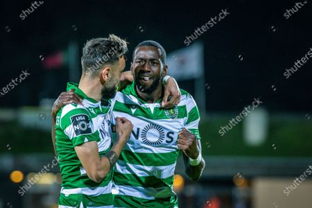 Sporting CP's Yannick Bolasie (R) celebrates with his teamate Bruno Fernandes (L) after scoring a goal against Santa Clara during the Portuguese First League soccer match between Santa Clara and Sporting CP held at Sao Miguel stadium in Ponta Delgada, Azores, Portugal, 16 December 2019.