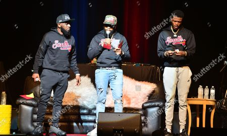 Comedian Karlous Miller, Chico Bean and DC Young Fly perform on stage during the 85 South improvs and freestyles comedy show at James L. Knight Center, Miami.