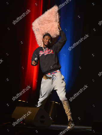 Comedian DC Young Fly performs on stage during the 85 South improvs and freestyles comedy show at James L. Knight Center Miami.