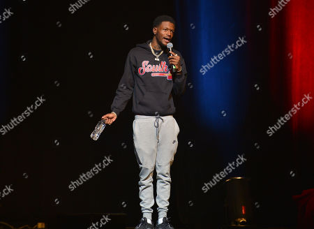 Stock Image of Comedian DC Young Fly performs on stage during the 85 South improvs and freestyles comedy show at James L. Knight Center, Miami, Florida, USA - 15 Dec 2019