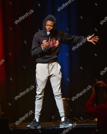 Stock Picture of Comedian DC Young Fly performs on stage during the 85 South improvs and freestyles comedy show at James L. Knight Center, Miami.