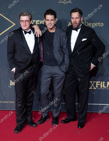 Directors Henk Handloegten, Tom Tykwer and Achim von Borries pose during the premiere of the third season of the TV series 'Babylon Berlin' at the Zoo Palast in Berlin, Germany, 16 December 2019. The German crime drama is based on novels by author Volker Kutscher.