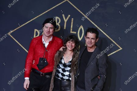 Lars Eidinger (L), Director Tom Tykwer (R) and his wife Marie Steinmann (C) pose during the premiere of the third season of the TV series 'Babylon Berlin' at the Zoo Palast in Berlin, Germany, 16 December 2019. The German crime drama is based on novels by author Volker Kutscher.