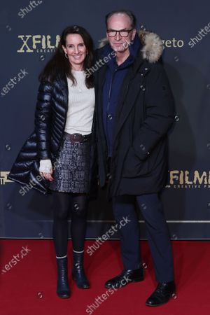 Herbert Knaup (R) and his wife Christiane Knaup pose during the premiere of the third season of the TV series 'Babylon Berlin' at the Zoo Palast in Berlin, Germany, 16 December 2019. The German crime drama is based on novels by author Volker Kutscher.