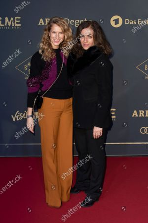 Stock Image of Chiara Schoras (L) and Turkish actress Ilknur Boyraz (R) pose during the premiere of the third season of the TV series 'Babylon Berlin' at the Zoo Palast in Berlin, Germany, 16 December 2019 (issued 17 December 2019). The German crime drama is based on novels by author Volker Kutscher.