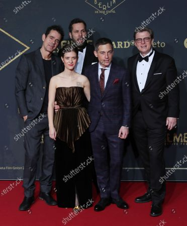 The cast members (first, L-R) Actress Liv Lisa Fries and actor Volker Bruch, (second, L-R) Directors Tom Tykwer, Achim von Borries and Henk Handloegten pose during the premiere of the third season of the TV series 'Babylon Berlin' at the Zoo Palast in Berlin, Germany, 16 December 2019. The German crime drama is based on novels by author Volker Kutscher.
