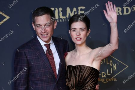 Stock Picture of Volker Bruch and Actress Liv Lisa Fries pose during the premiere of the third season of the TV series 'Babylon Berlin' at the Zoo Palast in Berlin, Germany, 16 December 2019. The German crime drama is based on novels by author Volker Kutscher.