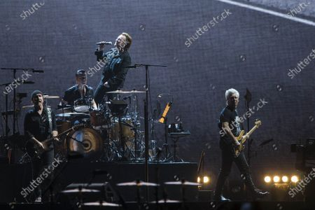 Stock Photo of Bono, The Edge, Adam Clayton and Larry Mullen Jr from Irish rock band U2 perform as part of The Joshua Tree tour at DY Patil Stadium in Nerul, Mumbai.