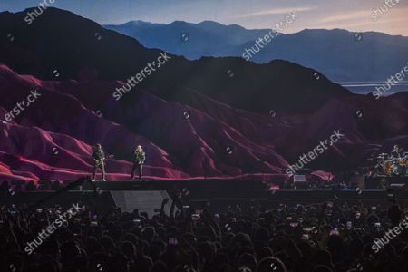 Stock Image of Bono, The Edge, Adam Clayton and Larry Mullen Jr from Irish rock band U2 perform as part of The Joshua Tree tour at DY Patil Stadium in Nerul, Mumbai.