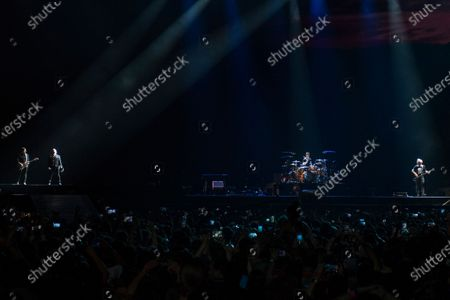Bono, The Edge, Adam Clayton and Larry Mullen Jr from Irish rock band U2 perform as part of The Joshua Tree tour at DY Patil Stadium in Nerul, Mumbai.