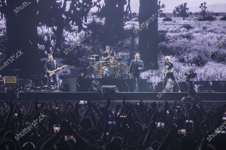 Stock Picture of Bono, The Edge, Adam Clayton and Larry Mullen Jr from Irish rock band U2 perform as part of The Joshua Tree tour at DY Patil Stadium in Nerul, Mumbai.
