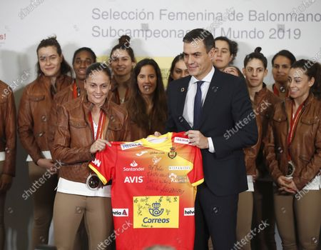 Stock Photo of Acting Spanish Prime Minister Pedro Sanchez (R) poses next to Spain's national handball team captain Silvia Navarro (L) and teammates during a welcome ceremony after their silver medal following the IHF Women's World Championship in Japan at Moncloa Palace in Madrid, Spain, 16 December 2019. Netherlands won Spain by 29-30 during the IHF Women's World Championship final match in Japan.