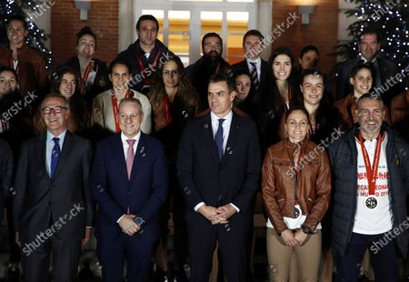 (L-R) Acting Spanish Minister of Sports and Culture, Jose Guirao, President of the Spanish Royal Spanish Handball Federation Francisco V. Blazquez, Acting Spanish Prime Minister Pedro Sanchez, Spain's national handball team captain Silvia Navarro, Spanish national handball team's head coach Carlos Viver and other players pose during a welcome ceremony after their silver medal following the IHF Women's World Championship in Japan at Moncloa Palace in Madrid, Spain, 16 December 2019. Netherlands won Spain by 29-30 during the IHF Women's World Championship final match in Japan.