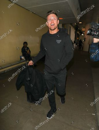Editorial image of Mike Mizanin at LAX International Airport, Los Angeles, USA - 16 Dec 2019