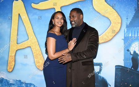 """Sabrina Dhowre, Idris Elba. Sabrina Dhowre, left, and Idris Elba attend the world premiere of """"Cats"""" at Alice Tully Hall, in New York"""