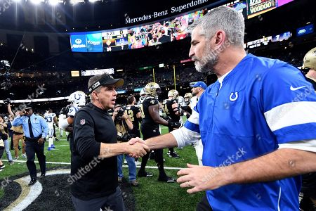 New Orleans Saints head coach Sean Payton, left, greets Indianapolis Colts head coach Frank Reich after an NFL football game in New Orleans, . The Saints won 34-7
