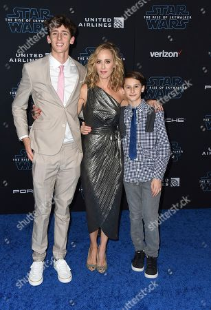 "Stock Image of Luke West Boyer, Kim Raver, Leo Kipling Boyer. Luke Boyer, from left, Kim Raver and Leo Boyer arrive at the world premiere of ""Star Wars: The Rise of Skywalker"", in Los Angeles"