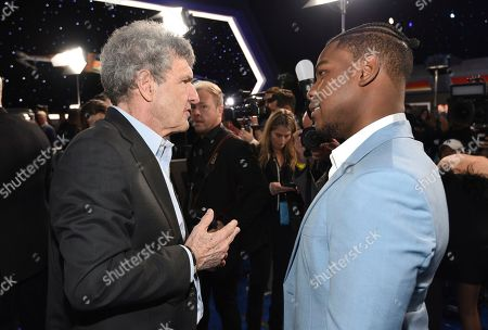 "Alan F. Horn, John Boyega. Alan F. Horn, CCO and co-chair, Walt Disney Studios, left, and John Boyega arrives at the world premiere of ""Star Wars: The Rise of Skywalker"", in Los Angeles"