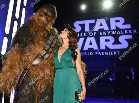 """Stock Photo of Emily Swallow, right, poses with a Chewbacca character upon arrival at the world premiere of """"Star Wars: The Rise of Skywalker"""", in Los Angeles"""