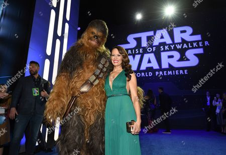 """Emily Swallow, right, poses with a Chewbacca character upon arrival at the world premiere of """"Star Wars: The Rise of Skywalker"""", in Los Angeles"""