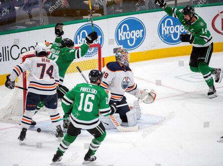 Dallas Stars' Joe Pavelski (16), Alexander Radulov (47) and Jamie Benn (14) celebrate a goal by Tyler Seguin in front of Edmonton Oilers goaltender Mikko Koskinen (19) and defenseman Ethan Bear (74) in the third period of an NHL hockey game, in Dallas. Edmonton won 2-1