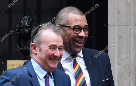 British Secretary of State for Wales Simon Hart (L) and Chairman of the Party James Cleverly depart Downing Street in London, Britain, 17 December 2019, after the first Cabinet meeting of the new Government.