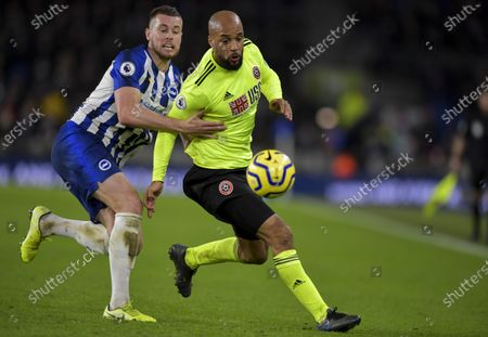 David McGoldrick of Sheffield United chased by Phil Jagielka of Sheffield United