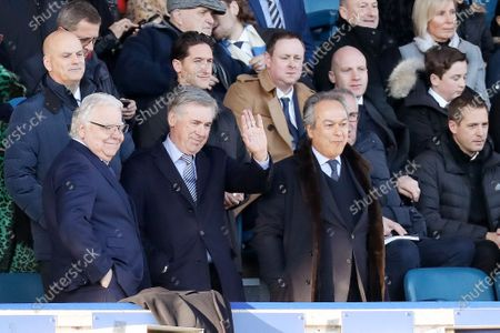 Everton manager Carlo Ancelotti waves as he stands next to Bill Kenwright and Farhad Moshiri i the directors box