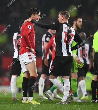Victor Lindelof of Manchester United and Emil Krafth of Newcastle United  at full time