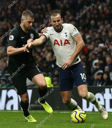 Harry Kane of Tottenham Hotspur battles with  Adam Webster of Brighton