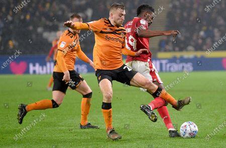 Jarrod Bowen of Hull City chases Yohan Benalouane of Nottingham Forest