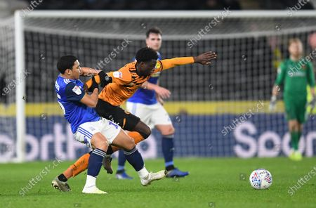 Leonardo Da Silva Lopes of Hull City is tackled by Jefferson Montero of Birmingham City