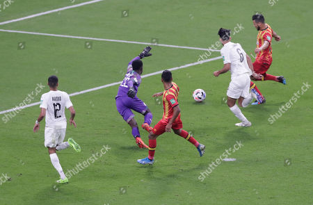 ES Tunis's Anice Badri, right, scores his side's second goal during the Club World Cup soccer match between AL Sadd and ES Tunis at the Khalifa International Stadium in Doha, Qatar