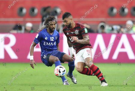 Gabriel Barbosa (R) of Flamengo in action against Yasser Al-Shahrani of Al Hilal SFC during the FIFA Club World Cup semi final soccer match between CR Flamengo and Al Hilal SFC in Doha, Qatar, 17 December 2019.