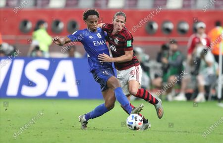 Filipe Luis (R) of Flamengo in action against Andre Carrillo of Al Hilal SFC during the FIFA Club World Cup semi final soccer match between CR Flamengo and Al Hilal SFC in Doha, Qatar, 17 December 2019.