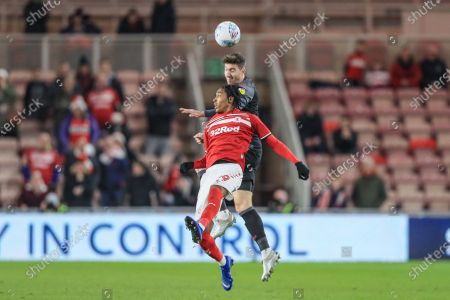 Stock Image of 20th December 2019, Riverside Stadium, Middlesbrough, England; Sky Bet Championship, Middlesbrough v Stoke City : Stephen Ward (3) of Stoke City wins the challenge with Djed Spence (29) of Middlesbrough 