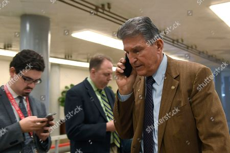 Sen. Joe Manchin, D-W.Va., walks on Capitol Hill in Washington