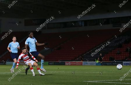 Jon Taylor of Doncaster Rovers scores the opening goal