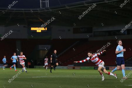 Jon Taylor of Doncaster Rovers celebrates scoring the opening goal